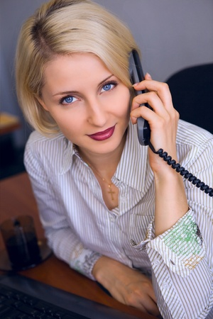 Young businesswoman talk on the phone in the office  Stock Photo - 9334718