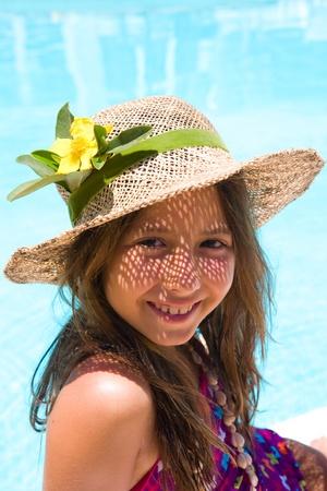 Little girl wearing a hat near pool Stock Photo - 9679792