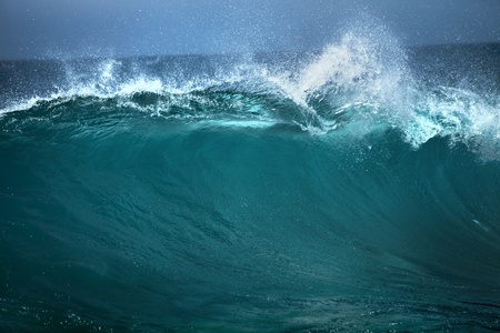 rushing water: Ocean wave,  good use of white text advertising on blue background  Stock Photo