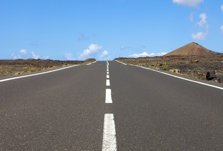 motorway: Empty road an arid mountain, Lanzarote, Canary islands, Spain  Stock Photo