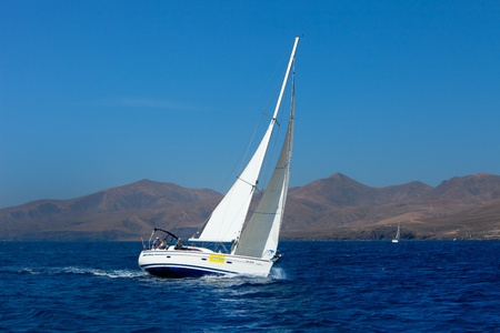 LANZAROTE, SPAIN - OCT. 12: one fully crewed yacht with number 3 out sailing with white sails in the Russian BOSS Regatta, Oct. 12 2011, Canary islands, Spain