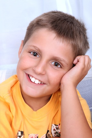 scallywag: Portrait of young smiling boy