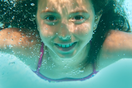 girl action: underwater girl in swimming pool