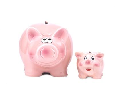 extra: Extra money - Piggy Bank on a white background Stock Photo