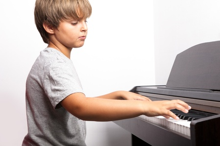 piano key: Young boy playing piano