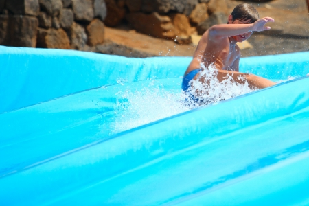 Child on water slide at aquapark  photo