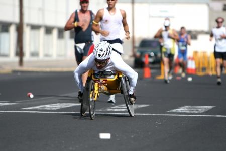LANZAROTE , SPAIN - NOVEMBER 29: Disabled athlete in a sport wheelchair during 2009 Lanzarote marathon on November 29, 2009 in Lanzarote, Spain.  Stock Photo - 24571092