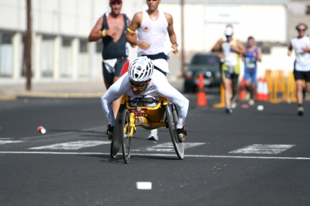 disabled sports: LANZAROTE , SPAIN - NOVEMBER 29: Disabled athlete in a sport wheelchair during 2009 Lanzarote marathon on November 29, 2009 in Lanzarote, Spain.