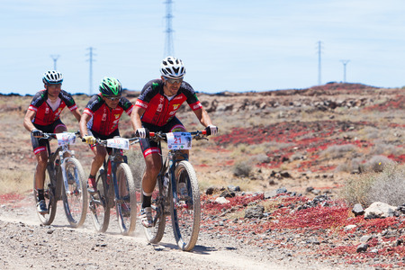 bikercross: LANZAROTE, SPAIN - MAY 03: Mariano Aguado N21, Antonio Acosta N18 in action at Adventure mountain bike marathon Ultrabike Santa Rosa May 03, 2015. Lanzarote, Canaries islands, Spain.