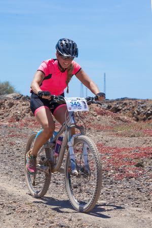 bikercross: LANZAROTE, SPAIN - MAY 03: Maria del Pilar N345 in action at Adventure mountain bike marathon Ultrabike Santa Rosa May 03, 2015. Lanzarote, Canaries islands, Spain.