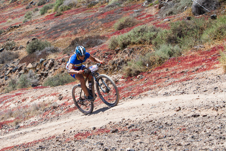 sergio: LANZAROTE, SPAIN - MAY 03: SERGIO RUIZ N195 in action at Adventure mountain bike marathon Ultrabike Santa Rosa May 03, 2015. Lanzarote, Canaries islands, Spain.