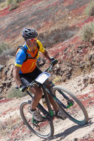bikercross: LANZAROTE, SPAIN - MAY 03: Carlos RIOS; N178 in action at Adventure mountain bike marathon Ultrabike Santa Rosa May 03, 2015. Lanzarote, Canaries islands, Spain.