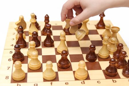 Hands playing wooden chess