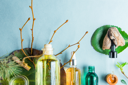 Homeopathic oils, dietary supplements for intestinal health Natural cosmetics, oils for skin care on a light background. Stock Photo