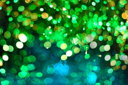 Green Neon Festive Christmas elegant abstract background with Purple and Neon bokeh lights and stars
