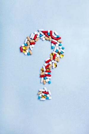 Question mark from Colorful medicines. Pills, tablets and capsules. Medical concept How to choose a pharmaceutical product.
