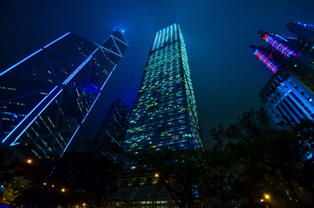 Skyscrapers of Hong Kong in the city center. Night shooting. City for careerists