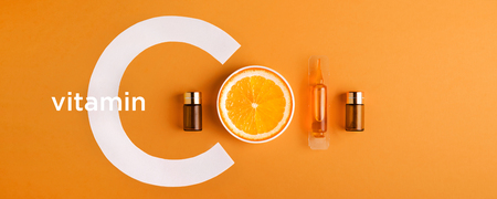 Serum and cosmetics with vitamin C. Essential oil from citrus fruits. banner Stock Photo