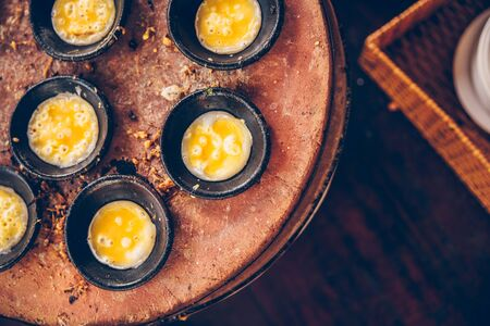 Vietnamese mini fried eggs, cooking on the street - Traditional Vietnamese food