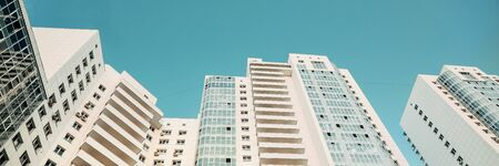 White new modern skyscrapers. New luxury residential complex. Texture Banner
