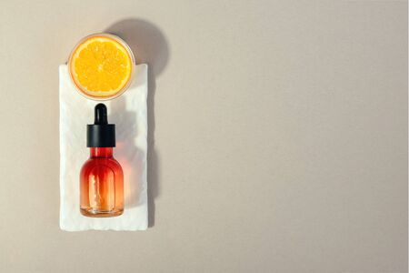 Natural cosmetic with vitamin C. Skin beauty health care concept.