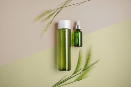 Natural cosmetics, serum for hair and skin care. Concept of treating hair for dryness and brittleness. Flat lay, pastel