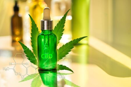 Glass bottle CBD OIL, tincture and cannabis leaf with cannabidiol formula on laboratory Stock fotó