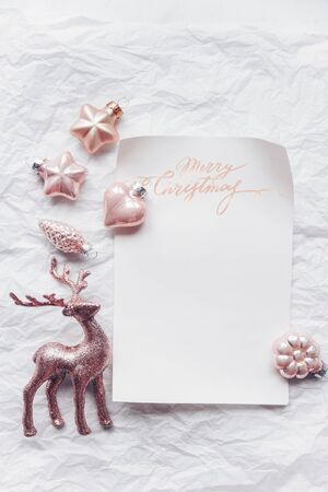 Composition with Cerulean deer and Christmas decorations in pastel colors. Flat lay, minimalism.
