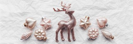 Composition with Cerulean deer and Christmas decorations in pastel colors. Flat lay, minimalism