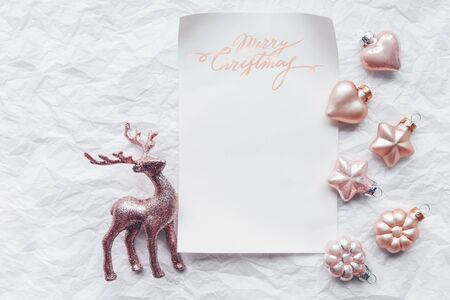Creative composition with Cerulean deer and Christmas decorations in pastel colors. Flat lay, minimalism.