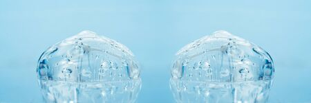 Texture of hyaluronic acid, serum gel, silicone implants, Transparent smear of gel on blue background