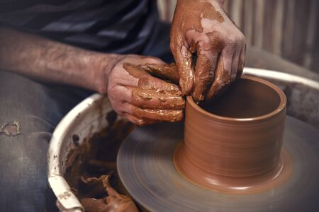 Pottery. The master at the potters wheel, produces a vessel of clay.