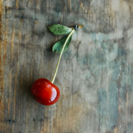 Ripe cherries on a wooden windowsill. Cottagecore Aesthetics. Rustic, vintage style Juicy summer concept Stock fotó