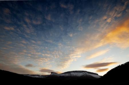 Sierra Salvada mountains with snow at the sunset and the clouds in the sky