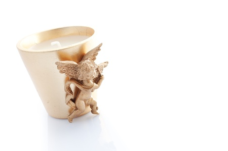 candle decorated with a winged angel isolated on white Stock Photo