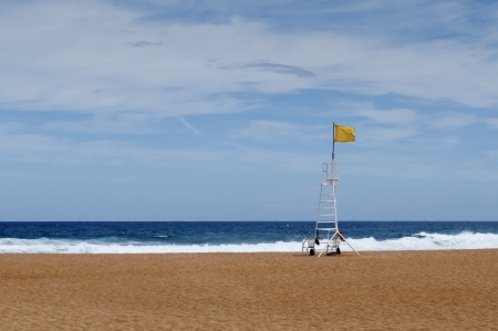 Yellow flag in the lifeguard station Stock Photo