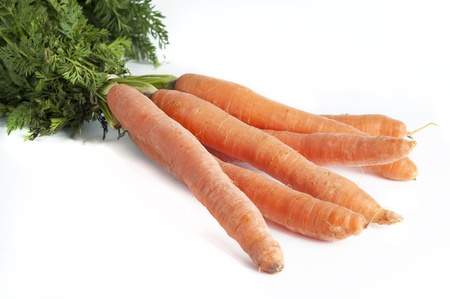 Bunch of fresh carrots isolated on white background Stock Photo