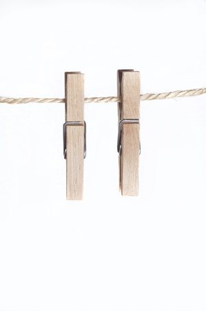 Two clamps for laundry hanging on a string Stock Photo - 15680646