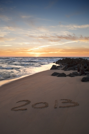 2013 writen on the sand at the sunset photo