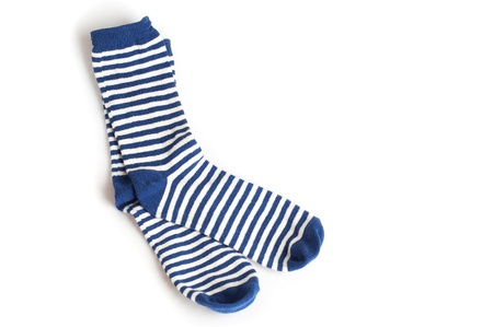 Two blue and white striped socks on white background