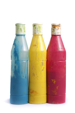three dirty paint cans, blue yellow and pink, isolated Stock Photo - 15835684