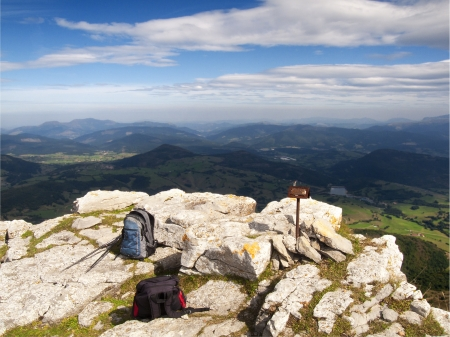 alava: backpacks on top of a mountain and valley views Stock Photo