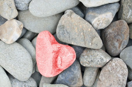 red pebble: heart shaped stone painted red