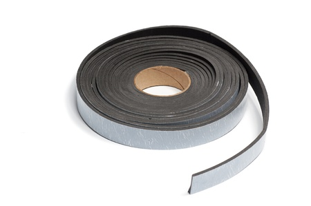 roll of black tape, isolated on white background photo