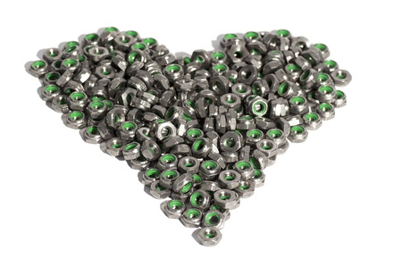 Metal nuts in the shape of heart isolated on white background photo