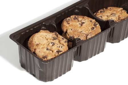 cookies packaged in a brown plastic container Stock Photo