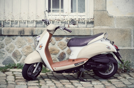Vespa motorcycle parked in the street