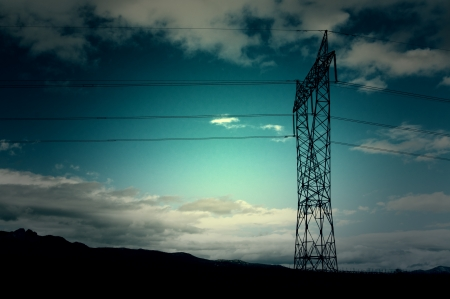 silhouette of a high voltage electrical tower Stock Photo