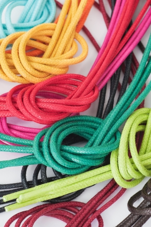 Shoelaces of different colors, knotted, isolated on white photo