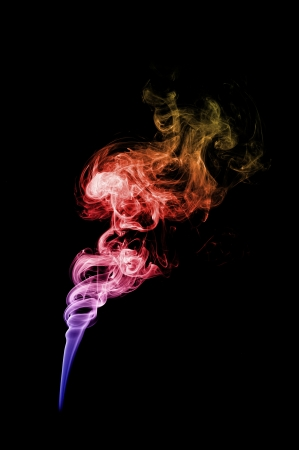 colored smoke in black background, on blue, pink, red and orange Stock Photo